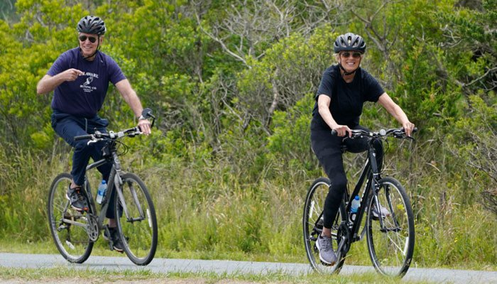 US President Joe Biden patrols on a bicycle with his wife